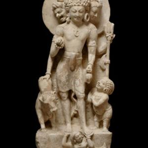 Three_headed_Shiva_with_Nandi_Prithvi_and_a_gana-North-west_India-Punjab-Salt_Hills-7th_8th_C-limestone-ht_58cmJohn_Eskenazi