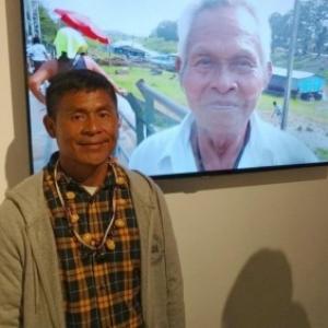 "Brodoloni Inacio Pinheiro Ngematucu, le fils de Pedro, present sur l'écran (c) M.PW./""Sud Info"""