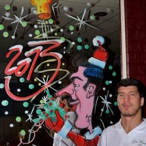 caricature du chef sur vitre miroir interieur du restaurant