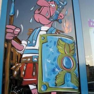 mantes la jolie, peinture sur vitrine pour le festival de la bande dessinee,