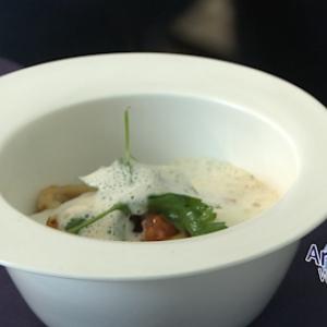 Riz Acquarello a l'encre de seiche, Jus amer, Emulsion de Parmesan, Chipiron & Tomates sechees