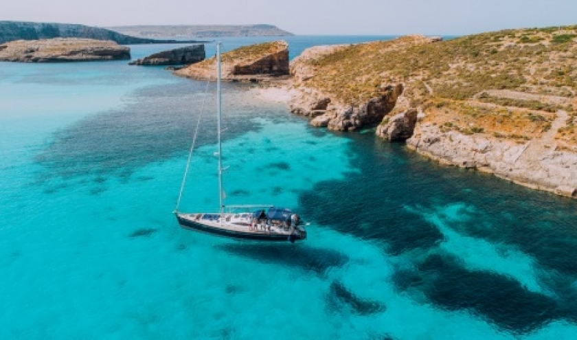 Aerial of Yacht in Blue Lagoon, off Comino